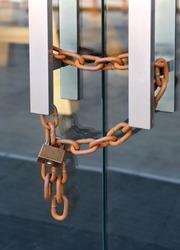 Locked glass door with chain