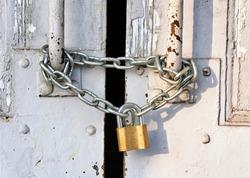Locked old and rusty door