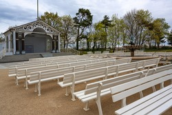 Locked open air stage and empty spectator benches near the beach during the coronavirus pandemic in the famous tourist resort Boltenhagen on the Baltic Sea, Germany, selected focus