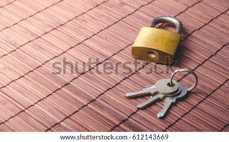 Locked padlock and keys #612143669