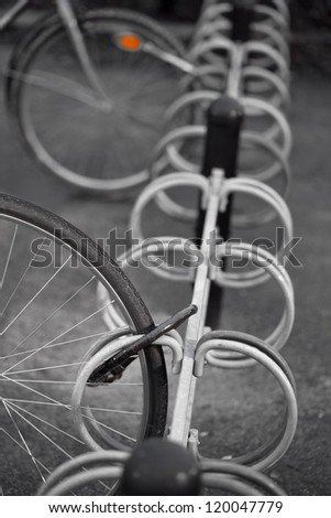 Locked wheel of bicycle in bicycle rack