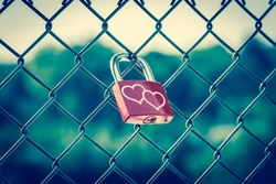 Lockers symbolizing love forever on the fence with vintage style