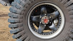Locking hubs and wheels. Manual locking hub on the front wheel hub with four-wheel drive tires for access to the backcountry with copy space. Choose content and focus