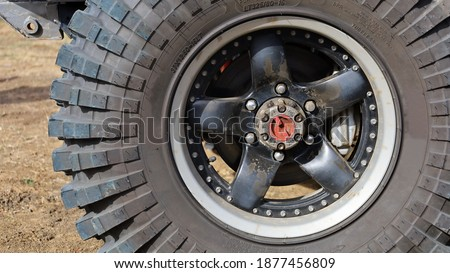 Locking hubs and wheels. Manual locking hub on the front wheel hub with four-wheel drive tires for access to the backcountry with copy space. Choose content and focus Stock photo ©