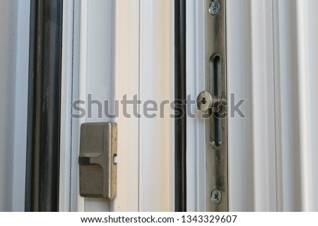 Locking point on a tilt and turn aluminum casement window with European groove mechanism