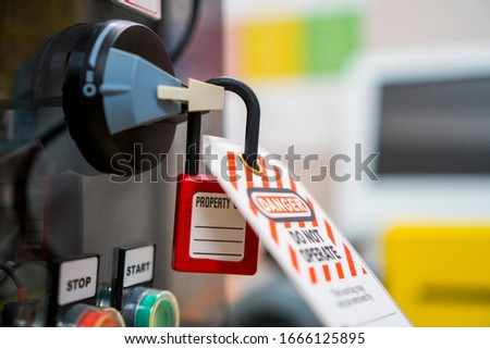 Lockout Padlock, Red Color. Lock Out & Tag Out. Electrical and Machine System and Safety Equipment.  Foto stock ©