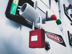 Lockout-tagout, safety lockout of the electric power feeder breaker.
