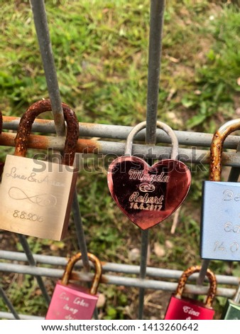 Locks at a fence as a symbol of eternal love put up by couples for example for their marriage