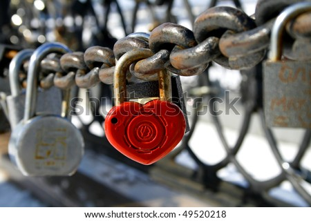 locks on the fence a tradition to hang the locks on the wedding, from the novel by Federico Mocha \