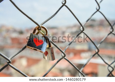 Locks on the fence of the bridge in lisbon as a symbol of eternal love