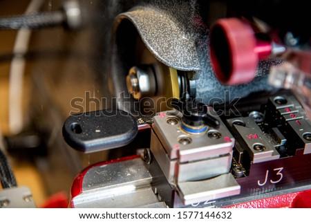 Locksmith key cutting machine - Car key replacement. New car key, chip key cutting.