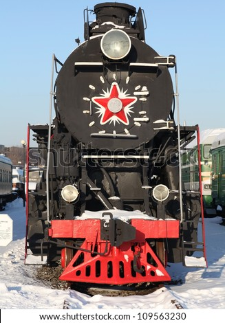 locomotive at a train station in winter,  front view