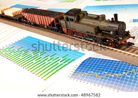 Locomotive Model on diagrams expenses - stock photo