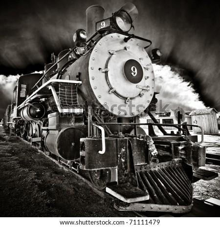 Locomotive number nine with dramatic sky