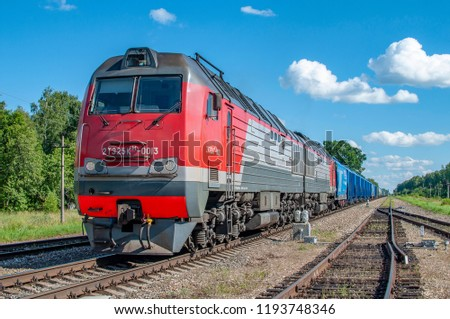 locomotive rzd 2te25 km with a train of blue wagons is at the station. Russia Smolensk.