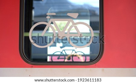 locomotive symbol for bicycle transport in Bernina express red train - Unesco heritage world  stock photo