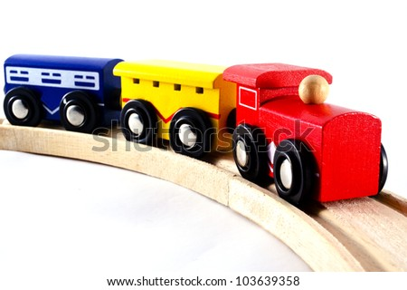 Locomotive train engine and rail cars model toy  isolated on a white background. Concept photo for transport ,transportation, retro, old, vintage ,design.