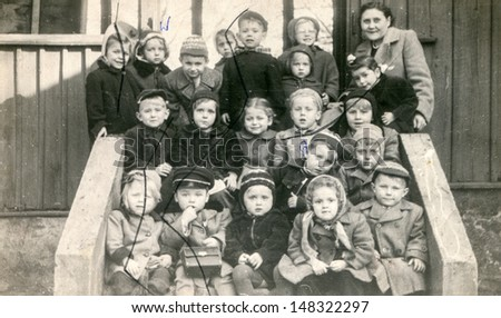 LODZ POLAND CIRCA FIFTIES vintage photo of group of pupils in kindergarten Lodz Poland circa fifties