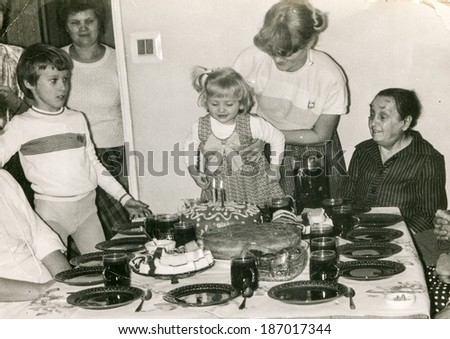LODZ POLAND CIRCA 1970's Vintage photo of family enjoying a family party child birthday