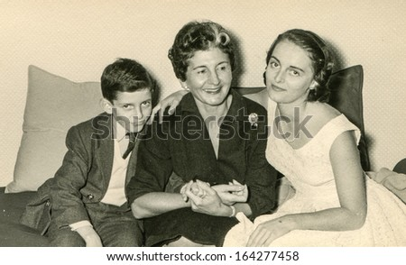 LODZ, POLAND - CIRCA SIXTIES: vintage photo of mother with unidentified daughter and son, Lodz, Poland, circa sixties