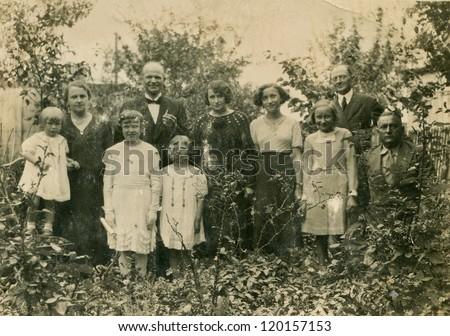 LODZ, POLAND, CIRCA 1935 - Vintage photo of big family in garden, Lodz, Poland, circa 1935