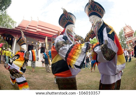 LOEI, THAILAND - JUNE 23: Phi Ta Khon Festival ( Traditional ghost mask festival ) Young people dress in spirit and wear a mask, sing and dance  on June 23,2012 in Loei Province,Thailand.