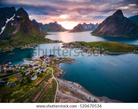 Photo of  Lofoten islands is an archipelago in the county of Nordland, Norway. Is known for a distinctive scenery with dramatic mountains and peaks, open sea and sheltered bays, beaches and untouched lands.