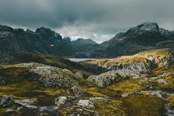Lofoten Islands Norway. Mountain autumn landscape. Hike to Mount Munken, alpine lake against a stormy sky