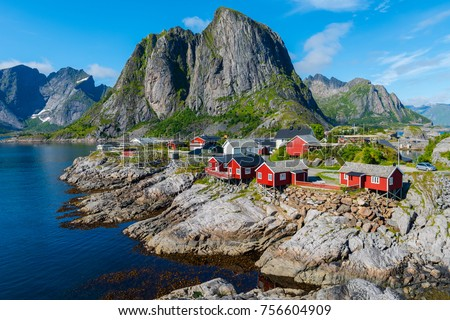 Photo of  Lofoten Summer Landscape Lofoten is an archipelago in the county of Nordland, Norway. Is known for a distinctive scenery with dramatic mountains and peaks