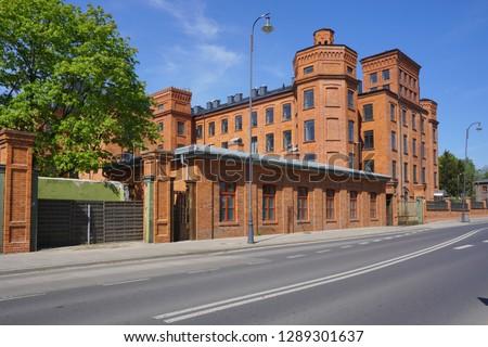 Loft Aparts. Ancient textile factory - details of architecture of the city of Lodz, Poland - revitalized buildings.