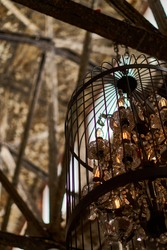 Loft atmosphere. An old bronze cage in an abandoned chic brick hall. Home for weddings and celebrations. The atmosphere of luxury and romance. High quality photo