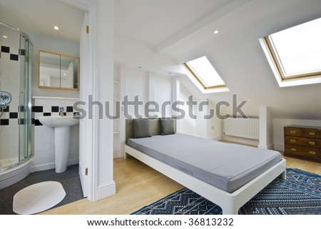 loft bed room with en suite bathroom and room window
