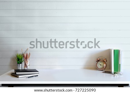 Shutterstock Loft desk work space with marble table, office supplies, documents, notebook and craft tools, mock up desk space concept.