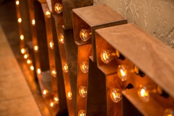Loft idea. Bulb lights on wooden stand