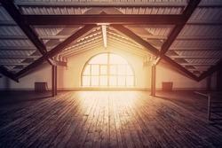 Loft Interior design. Sun rays from big arch window, wooden floor