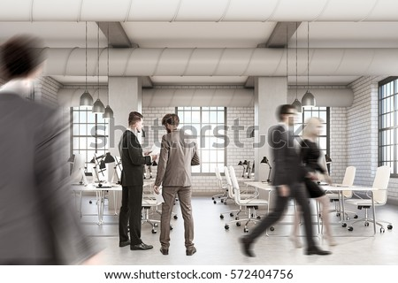 Loft open office with rows of computer tables. People are walking and discussing work. Concept of a busy office life. 3d rendering. Mock up.