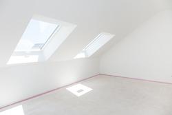 Loft refurbishment - empty room with skylight ready for renovation and new floor