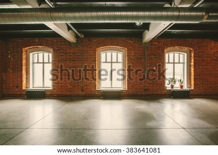Loft studio Interior in old house. Big windows, brick red wall #383641081