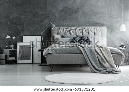 Loft style bedroom with gray design, concrete wall and modern furniture #691591201