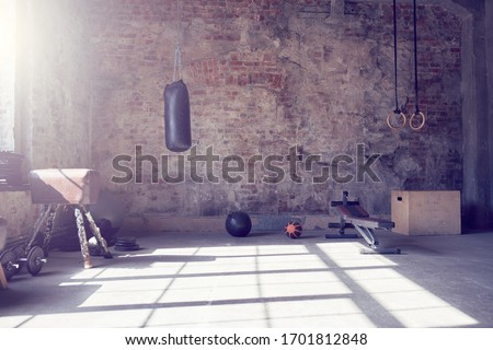 Loft style gym with old brick wall with sports equipment Foto d'archivio ©