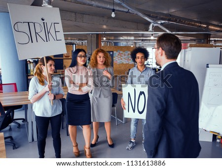 Loft style modern office, employees striking. Director negotiating with striking business team. Toned concept.