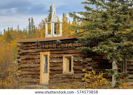 log building beside the...