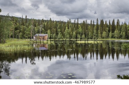 log cabbin by the lake in Finnish Lapland