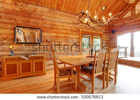 Log cabin dining room interior with custom furniture.