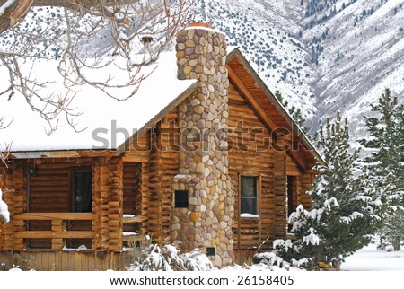 Log cabin in the mountains during the winter.