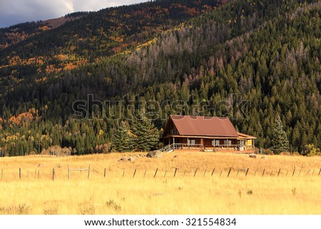 log cabin in the rocky...
