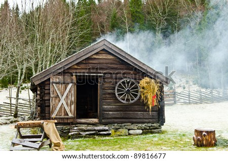 Log cabin in the wood in wintertime