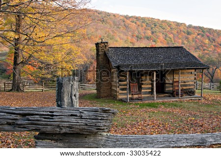 Log Cabin in Virginia Mountains with Fall colors and split rail fence