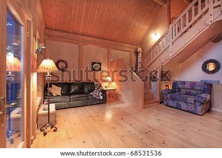 Log cabin living room in the evening light