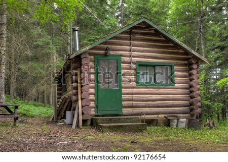Log cabin surrounded by the forest at Duck Mountain Provincial Park in Saskatchewan, Canada